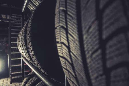 Winter Car Tires Shelf Storage Inside Large Residential Garage. Automotive Theme. Фото со стока