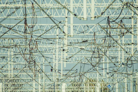 Electric Railroad Masts Traction Power. Registration Arms and High Voltage Wiring Infrastructure. Feed and Return Wires. Modern Railroad Technologies.