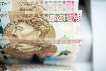 Five Hundred Polish Zloty Bills Count Inside Banknote Counter. Polish Business and Economy Theme. Currency of Republic of Poland. Фото со стока