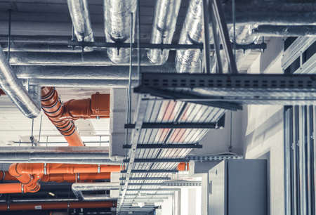 Sanitary, Power and Heating Pipelines System Inside Newly Built Commercial Building. Фото со стока