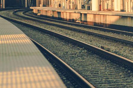 Modern Railroad Platform and Tracks Close Up. Rail Transportation Theme.