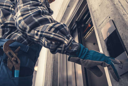 Professional Technician Calling For Elevator. Scheduled Warranty Maintenance of Residential Elevator.