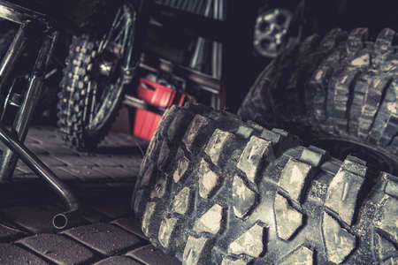 Large Tread Off Road Sport Utility Vehicle TypeTires Laying in a Garage Фото со стока