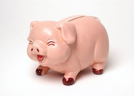 Pink piggy bank with a laughing expression on white background