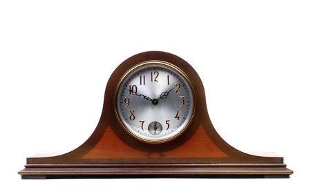 Straight on view of an old mantle clock Archivio Fotografico