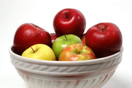 Ceramic bowl filled with apples of different varieties Banco de Imagens