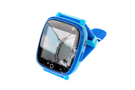 Multicolored kids smart watch phone with broken screen isolated on white background. Technology for children. Wearable gadget concept. Top view, close up. Time clock for school.