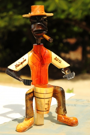holguin: Wooden figurine playing the drum Stock Photo