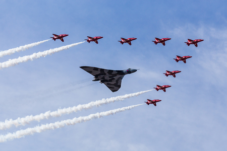 The Red Arrows escort XH558 for the final time - seen at the 2015 Southport airshow.