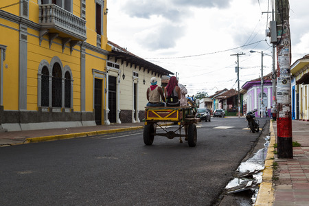 horse cart: A horse & cart travels along a street in downtown Granada, Nicaragua.
