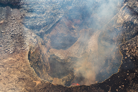 Molten lava sloshes around the bottom of the Santiago crater of the Masaya Volcano in Nicaragua.