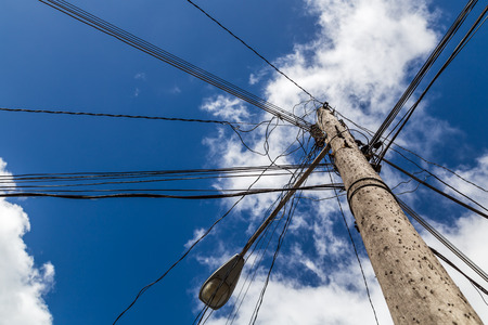 Telephone & electric wires spread out all directions from the top of a telegraph pole in the Cuban city of Sancti Spiritus.