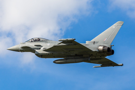 The RAF Typhoon performs a low flyover at Liverpool airport prior to landing.