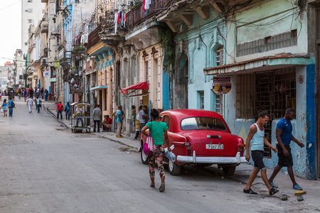 typically: A typically busy, characteristic & colourful street late one afternoon in Centro Havana.