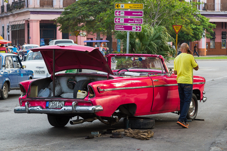 Tyre change on the Prado in Havana one evening - thankfully the driver managed to avoid the heat of the Caribbean sun.
