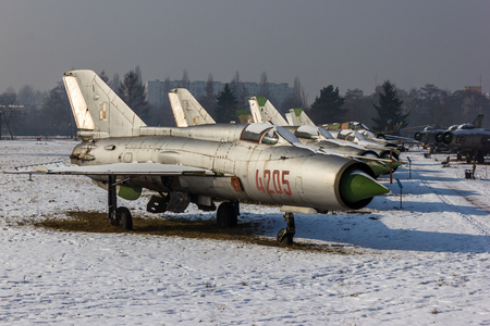 avion de chasse: Row of Polish MiG-21s marks the start of Mig Alley at the Polish Air Museum in Krakow. Éditoriale
