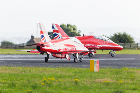 The last Red Arrow (from the Royal Air Forces display team) joins the rest of the team on the end of the runway at Liverpool airport ready to depart to their home base at RAF Scampton. Editorial