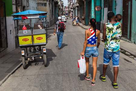 came: A young woman wearing the stars & stripes of the USA with her family in Centro Havana.  I came across other women wearing similar colours (US flag) whilst in Havana - times are changing it seems.