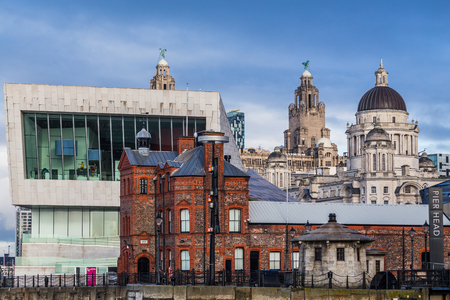 Old & new buildings along the famous Liverpool waterfront packed tightly in one frame.