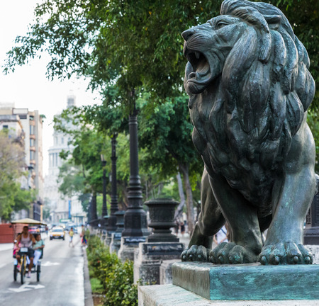 A lion statue on the end of the Prado in Havana.
