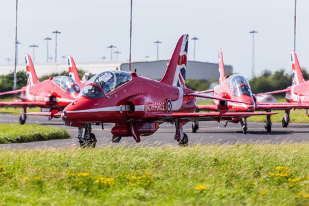Five of the ten Red Arrows of the Royal Air Force display team taxi out onto the runway at Liverpool airport ready to depart to their home base at RAF Scampton.