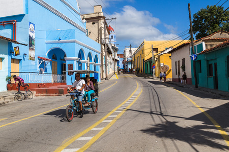 A local man enjoys a break from his cycling duties on his bicitaxi as he glides downhill in Sancti Spíritus.