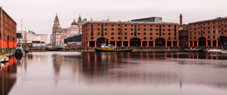 A colour panoramic image of the Albert Dock on the Liverpool waterfront.  Five long exposures were captured & merged to create this final image on a spring day.