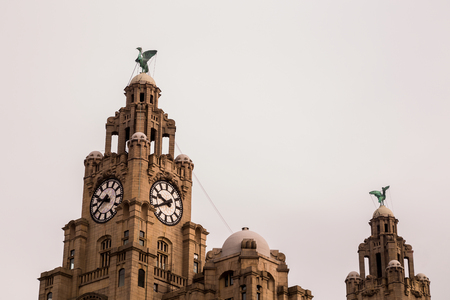 Close-up of the two Liver birds on the Liverpool waterfront on a bright but overcast day.