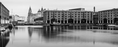 A monochrome panoramic image of the Albert Dock on the Liverpool waterfront.  Five long exposures were captured & merged to create this final image on a spring day. Editorial