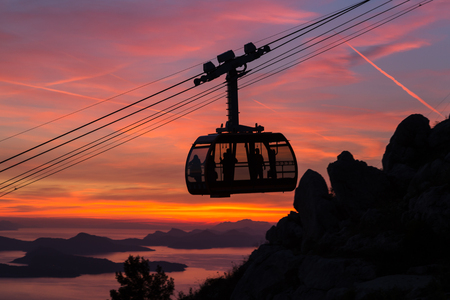 srd: The cable car which shuttles tourists from Dubrovniks old town to the peak of Srd Hill captured at sunset.