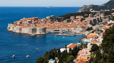Dubrovnik sandwiched between the clear turquoise water of the Adriatic & the mountains which separate Croatia from neighbouring Bosnia and Herzegovina.