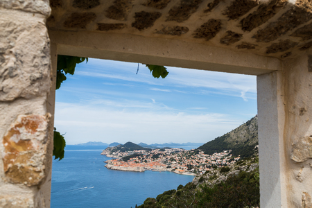 former yugoslavia: Looking through a doorway in Orsula Park towards the historic old town of Dubrovnik.