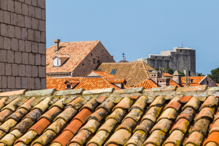 The colourful rooftops of Dubrovnik�??s old town.  Approximately 70% of these roofs were damaged during the conflict and had to be restored �?? hence their differing colour.  Some 5.3m new tiles were required to repair and restore the damaged rooftops fol