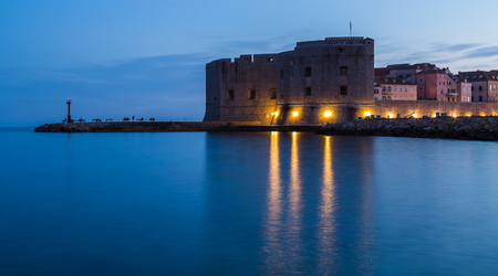The blue hourtwilight hour descends on the imposing structure of St John�s Fortress located at the entrance of Dubrovnik�s port.