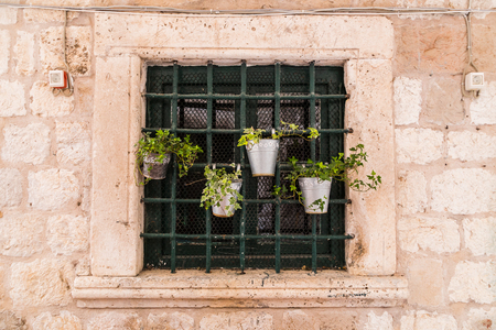 former yugoslavia: A tiny window garden pictured outside a house in Dubrovniks old town area. Stock Photo