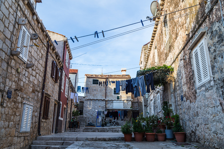 Laundry out on the line in a courtyard within Dubrovniks old city walls.
