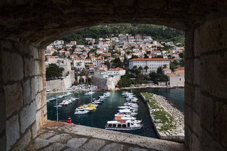 former yugoslavia: Small boats bobbling along the water in Dubrovnikâ??s old harbour - seen from a lookout on the city walls.