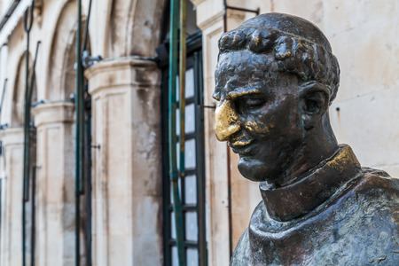 A statue of Marin Drzic in Dubrovnik - considered the finest Croatian Renaissance playwright and prose writer.  As a sign of good luck, people rub his nose whilst passing. Stock Photo