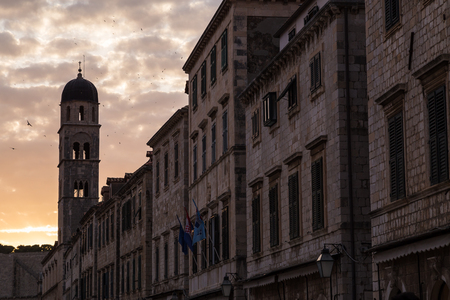 Church and bell tower of the Franciscan church seen along the Stradun in Dubrovnik, the main thoroughfare through the old town. Stock Photo