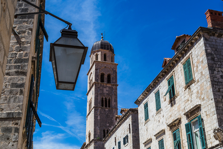 egalitarian: Dubrovniks famous main street, known as the Stradun is paved with glistening marble and lined with shop fronts that all look exactly the same. This egalitarian design was decided on when the town was rebuilt after the earthquake. Stock Photo