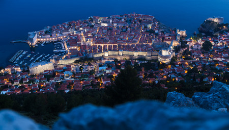srd: Long exposure of Dubrovniks old town pictured during twilight from the peak of Srd Hill.