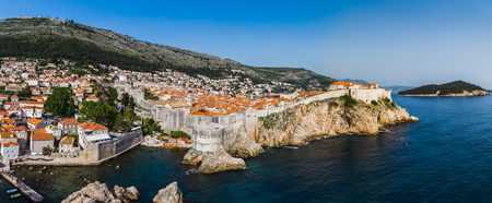 Rugged stone walls loop up and around Dubrovnik�s historic old town. Editorial