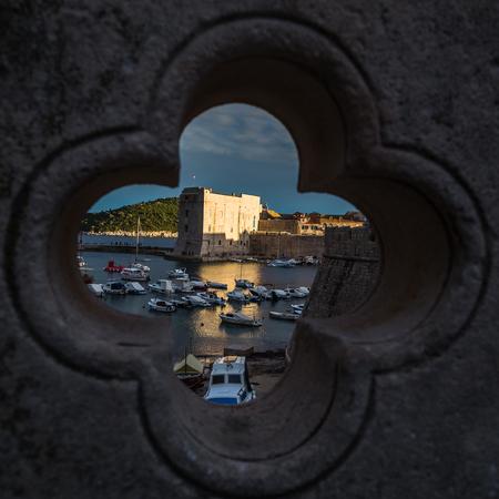 former yugoslavia: The descending sun illuminates St John�s Fortress on the edge of Dubrovniks old town. Stock Photo