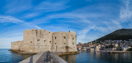 A multiple image panorama captured early one morning from the porporela (pier and breakwater in Dubrovniks old harbour).  It was originally built in the old times to reduce the intensity of waves, reduce erosion and protect boats and ships anchored in the Stock Photo
