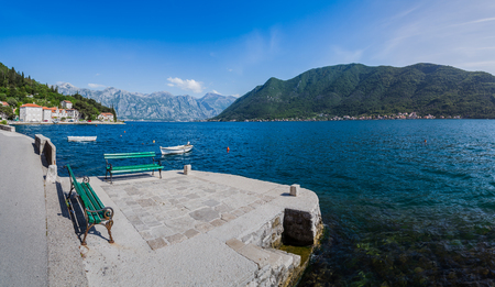 A multiple image panorama captured on the quay in historic town of Perast in the Bay of Kotor, Montenegro, late one Spring afternoon.
