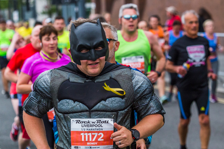 A man dressed up as the character Batman running for charity in the 2017 Liverpool Rock n Roll half marathon on 28 May 2017.