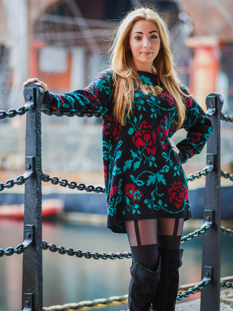 Three quarter length portrait of Alex standing by the black railings at the Albert Dock on the Liverpool waterfront. Stock Photo