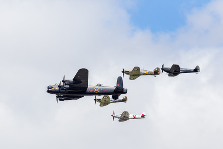 Battle of Britain Memorial Flight (featuring a Lancaster and five fighters) at the 2017 Royal International Air Tattoo at Royal Air Force Fairford in Gloucestershire - the largest military airshow in the world.