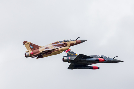 Mirage 2000D pair from Couteau Delta seen at the 2017 Royal International Air Tattoo at Royal Air Force Fairford in Gloucestershire - the largest military airshow in the world. Editorial