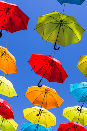 Some of the two hundred colourful umbrellas pictured hanging above a street in Liverpool city centre to raise awareness about ADHT.